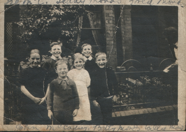 Isa (left) and John (front) Macartney outside no. 37 Rutland Street with the Monds children.