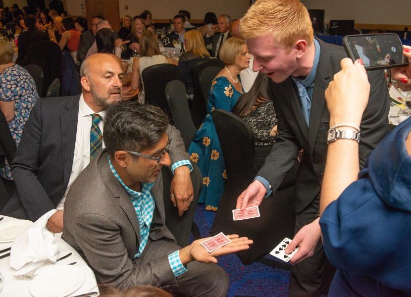 Scott Baird entertaining Sanjeev Kohli & Geoff Leask with his magic!