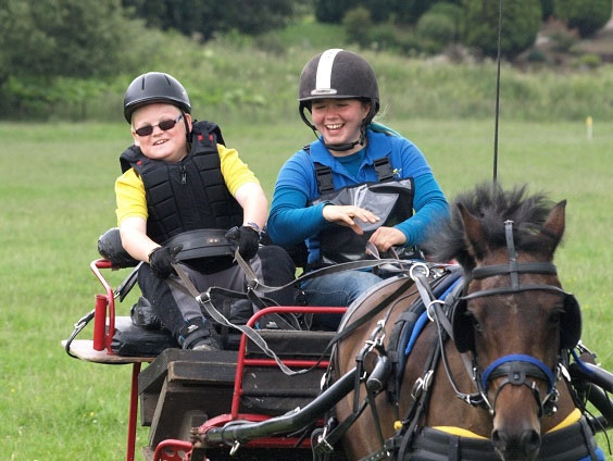 Photo that a parent has sent us of their child with CVI enjoying carriage driving.