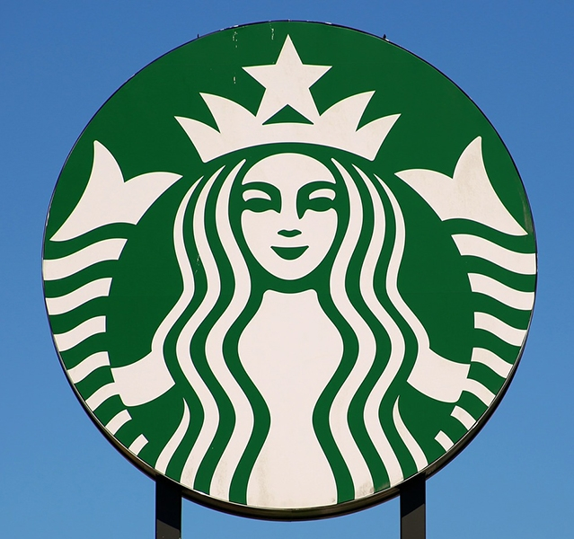 Whilst randomly looking around (visually searching) in an unknown airport Mary's visual attention stopped when it found something meaningful, in this case the sign for a  Starbucks coffee shop.