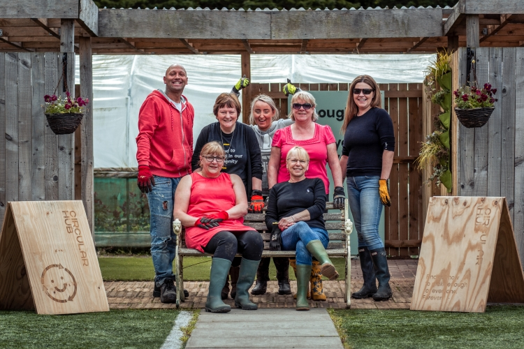 The Outdoor Classroom can be seen in the background during a volunteering day with Marks and Spencer