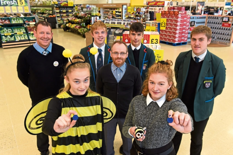 Pupils from Hazlehead Academy who are part of the YES programme, Richard Corrigan of Elevator/YES, and Stuart Neil the new manager at Tesco Woodend. Picture of (L-R) Stuart Neil, Chloe Ferries, 17, Sean Paterson, 17, Richard Carmack Corrigan, James Gomes, 17, Beth Reid, 17, Paul Walker, 17.